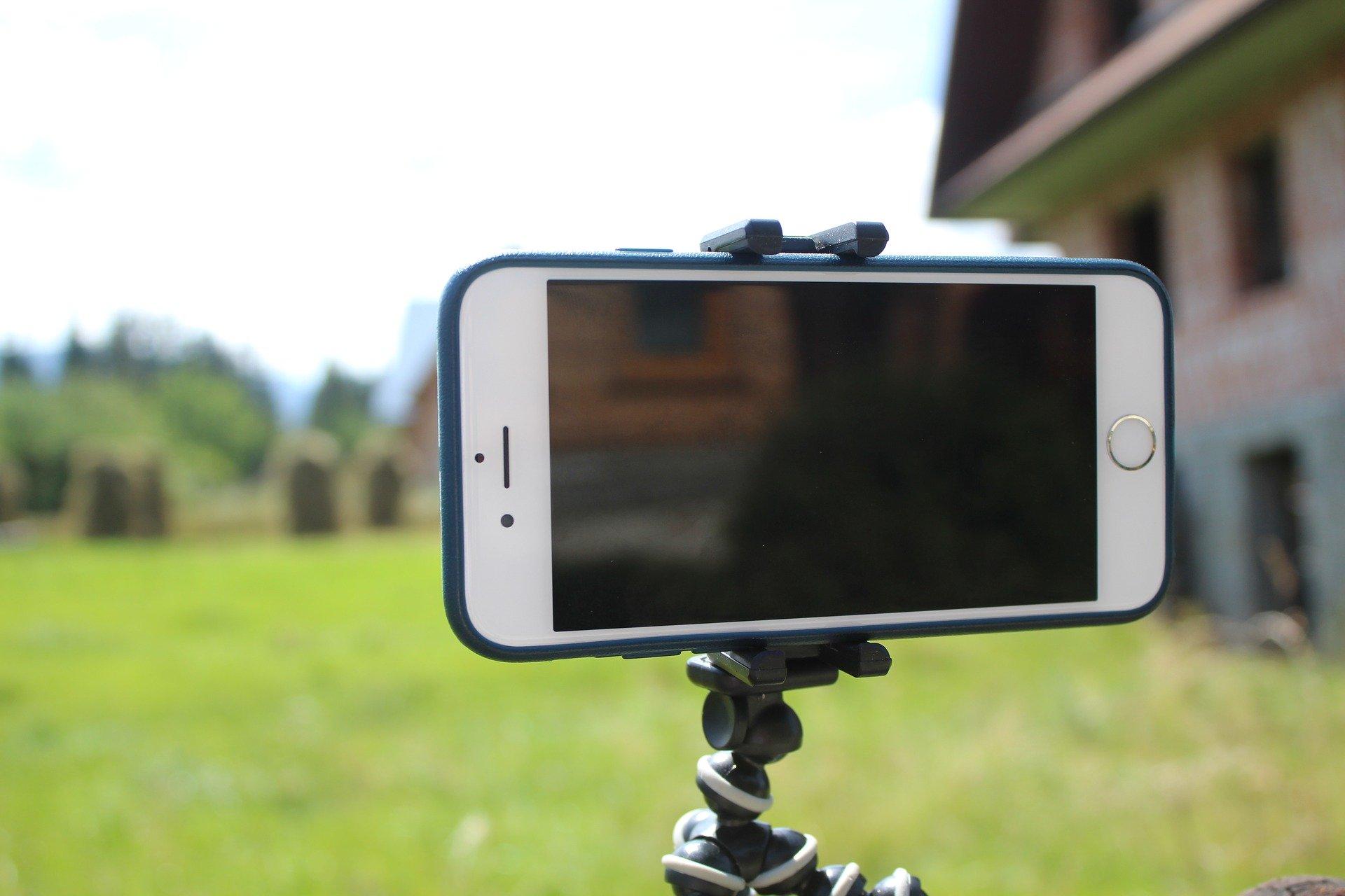 a phone tripod holding a phone